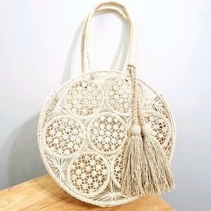 Teiruma Handcrafted Straw Round Bag With Tassels